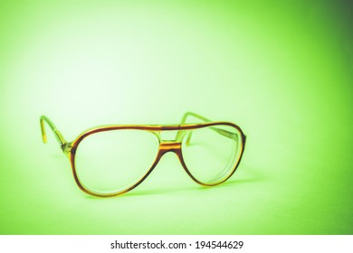 image of a reading spects  on a green vintage background