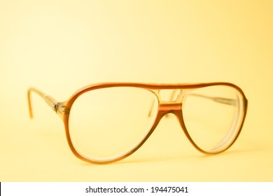 image of  reading spects  on an orange / yellow background