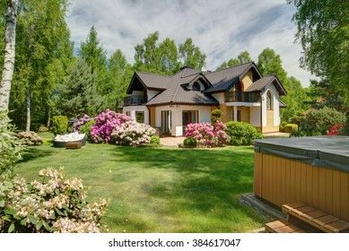 Image of recreational area beside house with large lawn