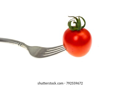 Image of red cocktail tomatoes on fork. Concept of vegetarian food. Studio Photo