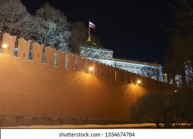 Image of the Red Kremlin wall and Residence of the President of the Russian Federation in Moscow in the night. Flag, national symbol of Russian Federation over the Kremlin. Long exposure image.