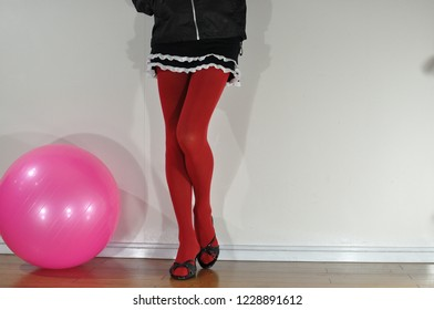 Image of red stockings and miniskirt legs