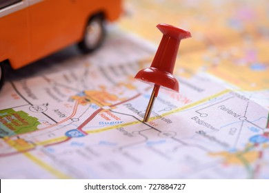 image of red straight pin with travel map background./  with copy space.macro style.soft focus