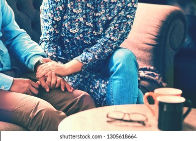 Image of Relationships in Middle Adulthood.Husband and wife hold their hands together.The encouragingly of a good relationship in middle age couple.Love,support,consult,Marital satisfaction and care