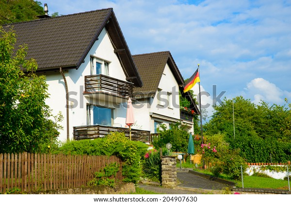 Image of a residential area in Germany proudly displaying the german flag after Germany became the new world champions in July 2014