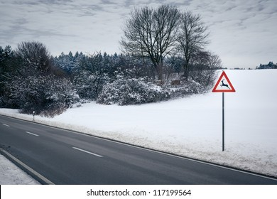 An image of a road in a winter scenery