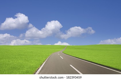 An image of Road,clouds and grassland