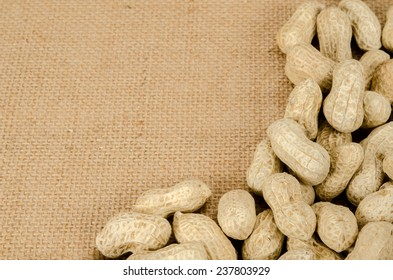 Image of roasted peanuts on brown sack background