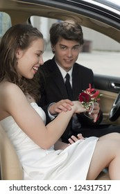 Image of romantic young couple on car