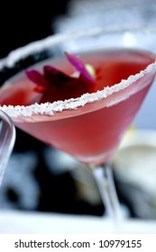 an image of a rose colored salted martini