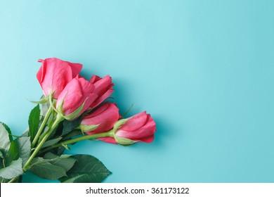 Image of roses on aquamarine background