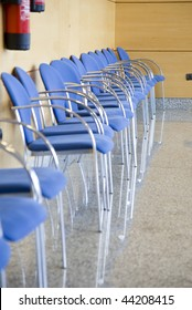 image of a row of chairs in a waiting room
