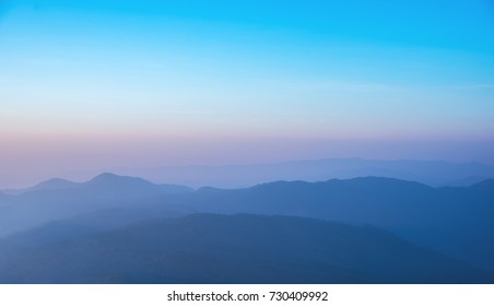 image of row of mountain on morning time to see mist covered on hight peak line.