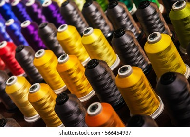 Image of rows of spindles with multicolored threads
