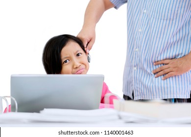 Image of sad schoolgirl being punished by her teacher with ears pulled while using a laptop, isolated on white background