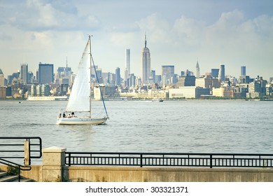 An image of a sailing boat in front of New York Manhattan