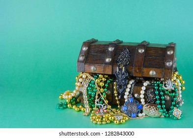 Image for Saint Patrick's Day on March 17th. Treasure chest to symbolize luck and wealth is filled with costume jewelry and beads. Copy space
