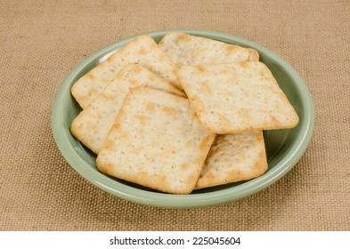Image of saltine crackers on brown sack background