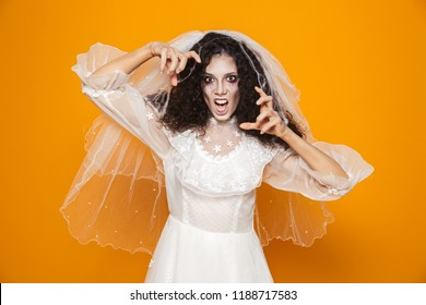 Image of scary dead bride on halloween wearing wedding dress and makeup terrifying isolated over yellow background