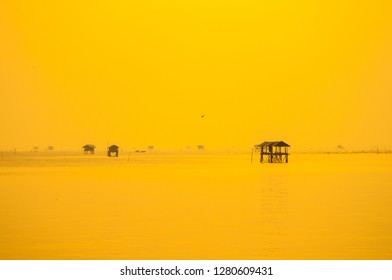 Image of Seascape for background, A little homestay in the sea with golden of sunlight. Small house in the morning on the ocean at Gulf of Thailand. Accommodation for people who cultivate sea shells.