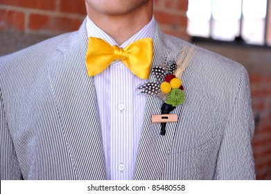 Image of a Seersucker Suit with yellow bowtie and boutonniere