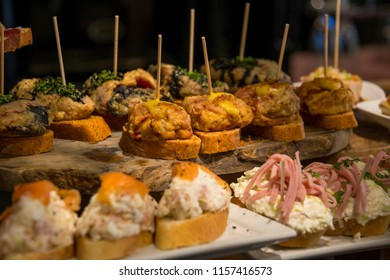 Image with selective focus of various tapas and pinchos in the display of a bar-restaurant in Bilbao, Vizcaya, Basque Country, Spain