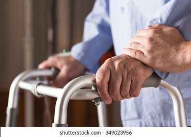 Image of senior disabled person holding walking zimmer