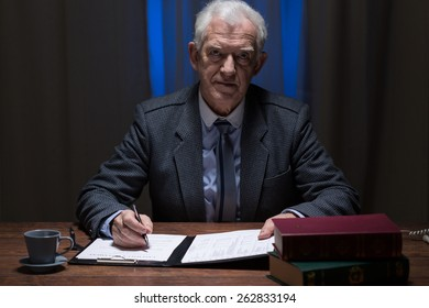Image of senior lawyer working at night