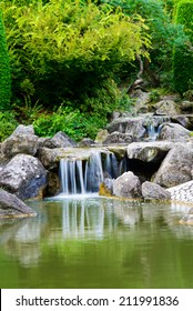 Image of a serene waterfall in the Rheinhaue in Bonn, Germany. A recreational park that covers approximately 40 acres with many attractions