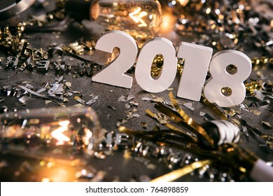 Image from a series celebrating New Year's Eve, some with 2018 numerals.  Lots of confetti, champagne, etc. Good for backgrounds of ads.