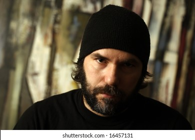 Image of a serious man with beard and beanie.