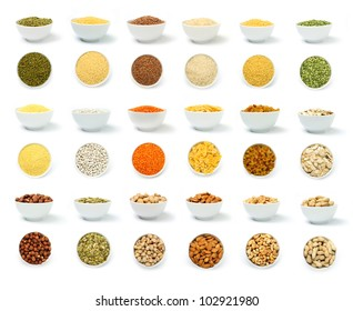 An image of a set of groats and nuts in white bowls