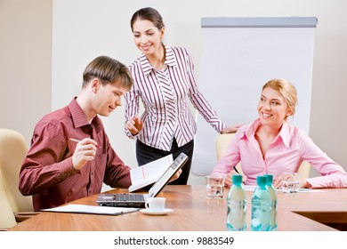 Image of several business people working in the office