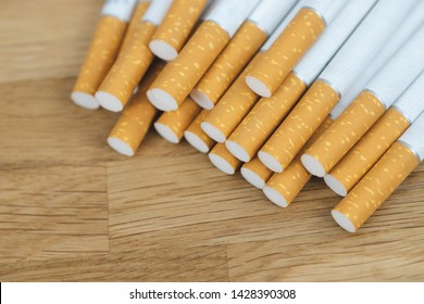 image of several commercially made cigarettes. pile cigarette on wooden. or Non smoking campaign concept, tobacco