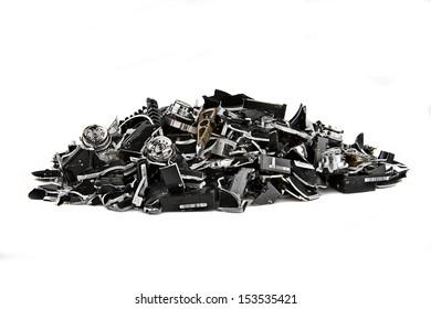 Image of several demolished hard drives on white