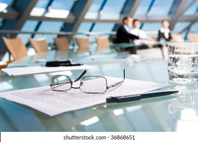 Image of several objects lying on the table in the conference room