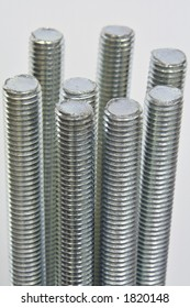 An image of several sticks of threaded rod