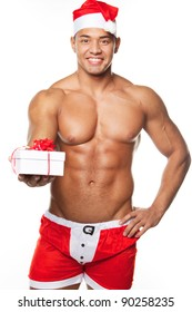Image of sexy man wearing santa claus costume, isolated on white