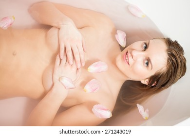 Image of sexy woman bathing with flowers