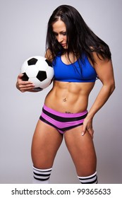 Image of sexy woman with soccer ball