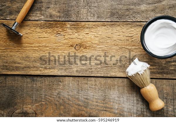 image of shaving tools : brush, foam, shaver.