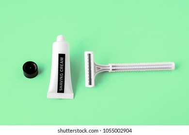 image of shaving tools : foam, shaver. Safety razor with shaving cream on green background, for men or for women, man, woman, shaving procedure for face, legs, hands, bikini