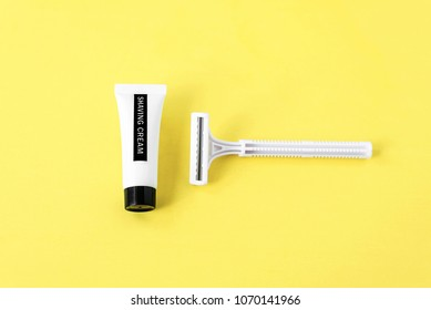 image of shaving tools : foam, shaver. Safety razor with shaving cream on yellow background, for men or for women, man, woman, shaving procedure for face, legs, hands, bikini