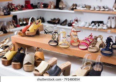 image of shelves with sandals in the shoes shop.