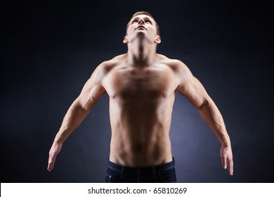 Image of shirtless man looking upwards in front of camera