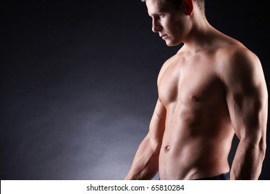 Image of shirtless man over dark background