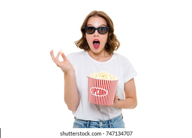 Image of shocked caucasian woman holding pop corn wearing 3d glasses standing isolated. Looking camera watch film.