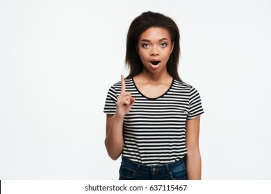 Image of shocked young african lady standing isolated over white background. Looking at camera have an idea.