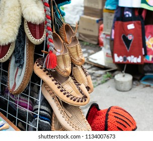 Image shoes traditional Serbian shoes(opanke) hanging at an outdoor souvenir store at Belgrade.