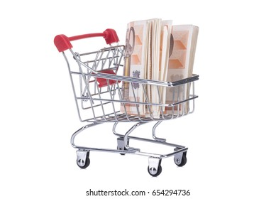 Image of Shopping cart with money isolated on white